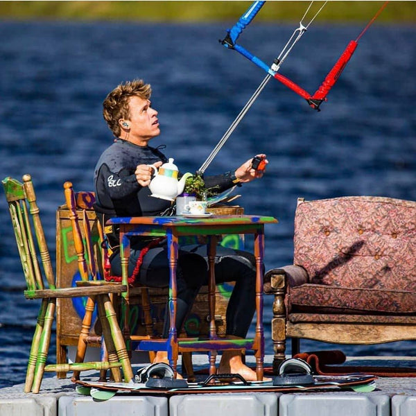 Kevin Langree drinking tea and kiteboarding