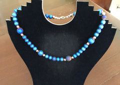 Sterling silver and frosted glass bead necklace.  An Original Design by Angie