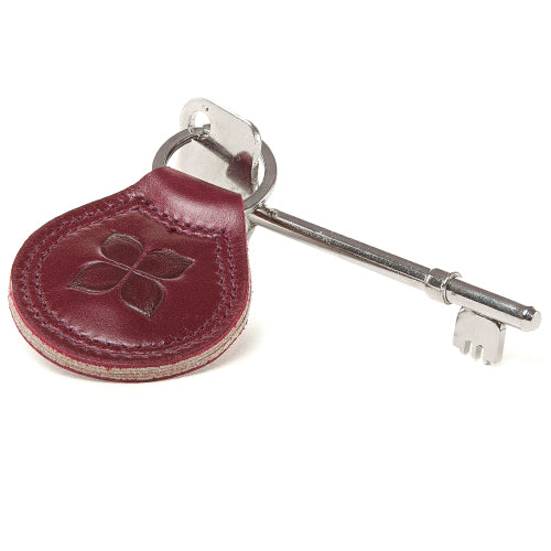 RADAR Disabled Toilet Key with Leather Keyring in Burgundy with blue badge company logo embossed on top and places against a white background