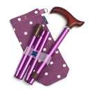 Adjustable Folding Walking Stick in Purple & Fabric Storage Bag in Purple Spotty behind white background with blue badge company label showing