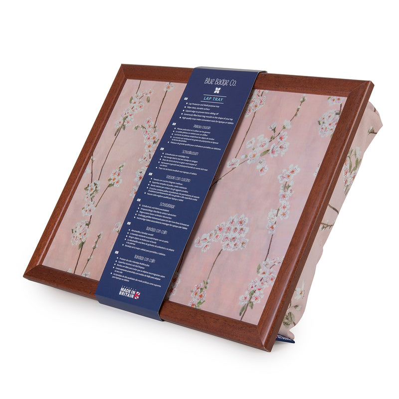 The Cherry Blossoms lap tray against a white background with a Blue Badge Co cardboard banner around it