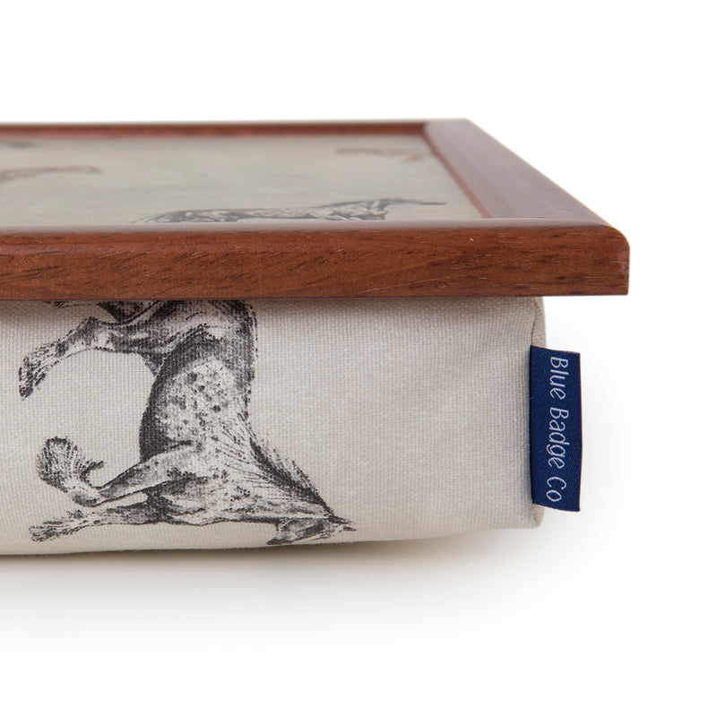 The corner of the Horse and Pony lap tray, showcasing the dark wood frame and Blue Badge Co label