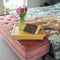 Canary Yellow Lap Tray with cushion on a bedside with book and pink flowers