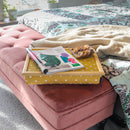Canary Yellow Lap Tray with cushion on a bedside with magazine and biscuits on