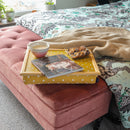 Canary Yellow Spotty Lap Tray on a bed with magazine, biscuits and candle on the top