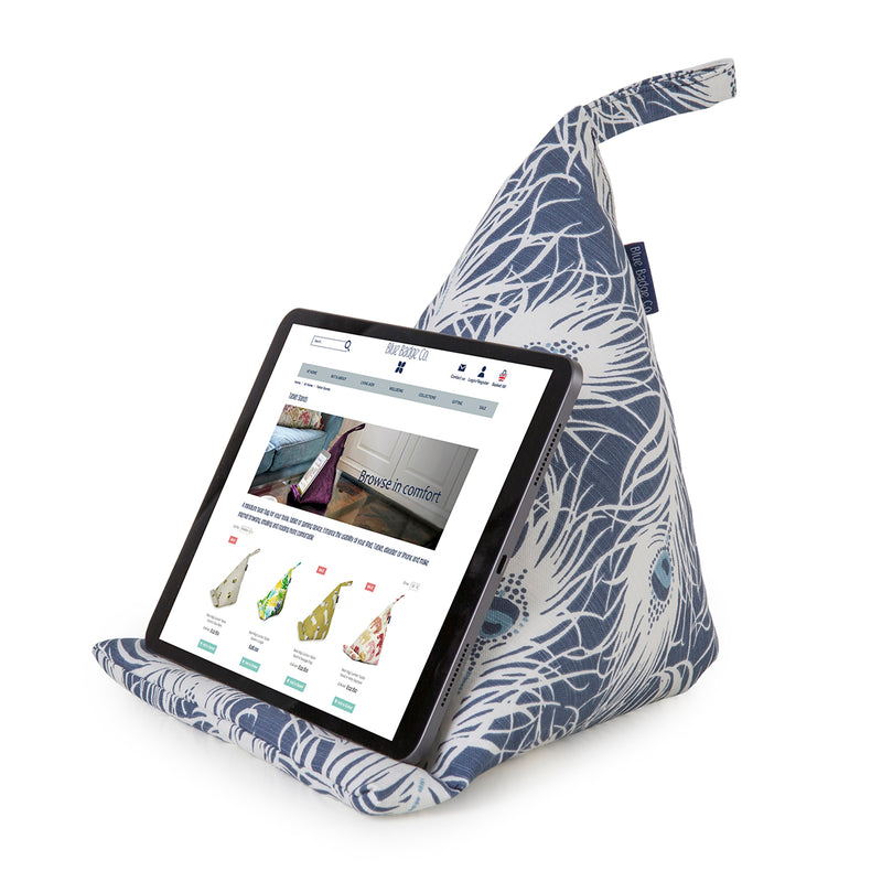 Bean bag tablet stand in Peacock print with a tablet on it showing the Blue Badge Co website