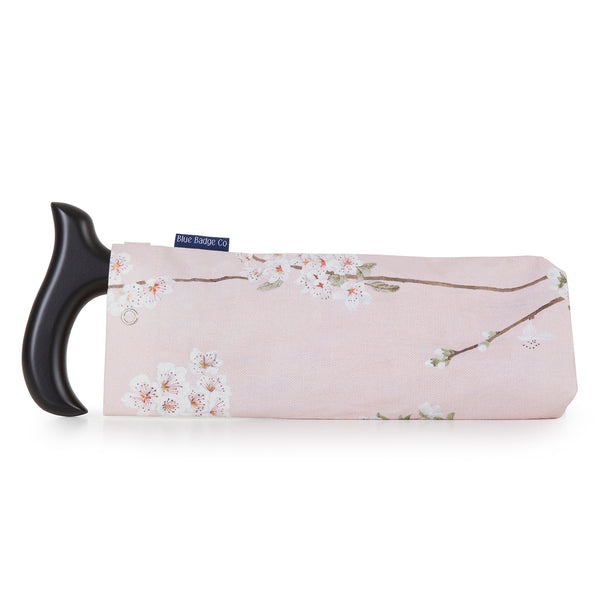 Stylish Fabric Storage Bag for Folding Walking Stick in Cherry Blossoms with walking stick inside as example of how it is used