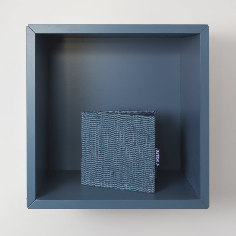 Disabled Blue Badge Wallet in Herringbone at home on blue shelf
