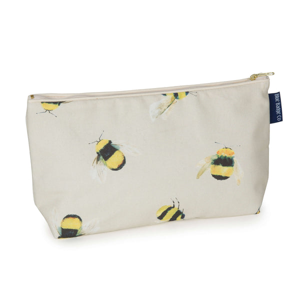 Toiletry Bag, Wash Bag  in Busy Bees with cream zip and blue badge company label showing against a white background