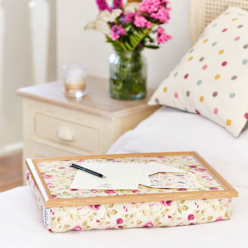 Bean Bag Lap Tray in Mulberry Rose print on a bed with a letter and pen on top