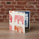 Disabled Blue Badge Wallet in Nelly Elephant at home on desk with brick wall behind