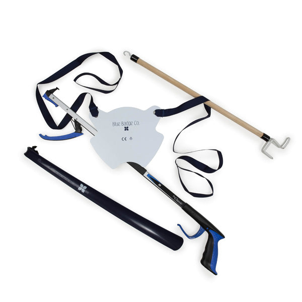 Easy Reach Bundle - Sock Aid, Shoe Horn, Dressing Stick and Reacher all behind at white background