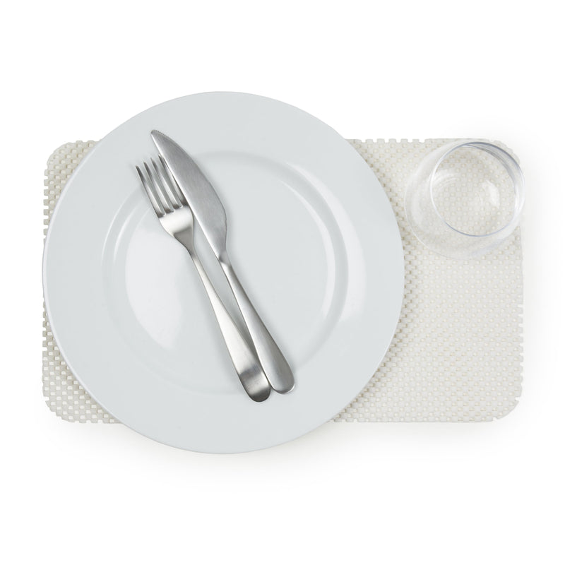 Non-slip placemat in cream colour with plate, cutlery and a glass on top, slip resistant