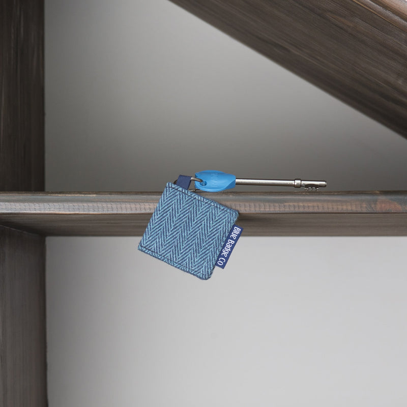 Genuine RADAR Disabled Toilet Key & Fabric Keyring in Herringbone with blue badge company label visible on shelf at home