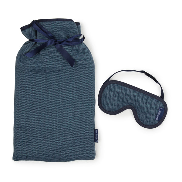 Large Hot Water Bottle and Lavender Eye Mask in Herringbone with blue badge company label showing against a white background