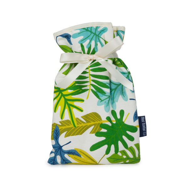 Mini Hot Water Bottle in Jungle with white satin ribbon and blue badge company label showing