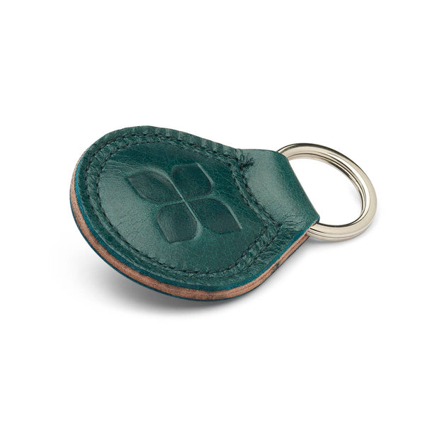 Italian Leather Key Ring in Lake Green with blue badge company logo embossed on the front and placed against a white background