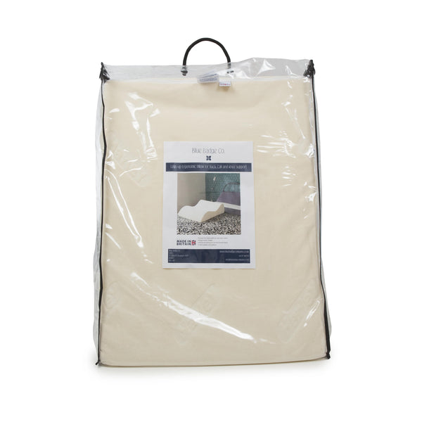 Legs-up ergonomic pillow in packaging bag