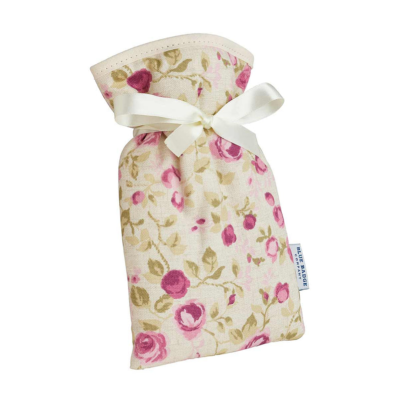Mini Hot Water Bottle in Mulberry Rose with white satin ribbon and blue badge company label showing