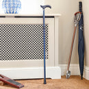 Adjustable Folding Walking Stick Cane in Navy is fully extended and stood up in porch at home next to umbrellas