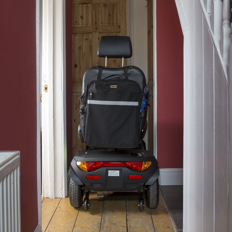 Large Waterproof Mobility Scooter Bag in Black with pockets attached to wheelchair in hallway