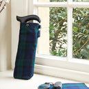 Fabric Storage Bag for Folding Walking Stick in Blackwatch Tartan at home on a windowsill next to car keys