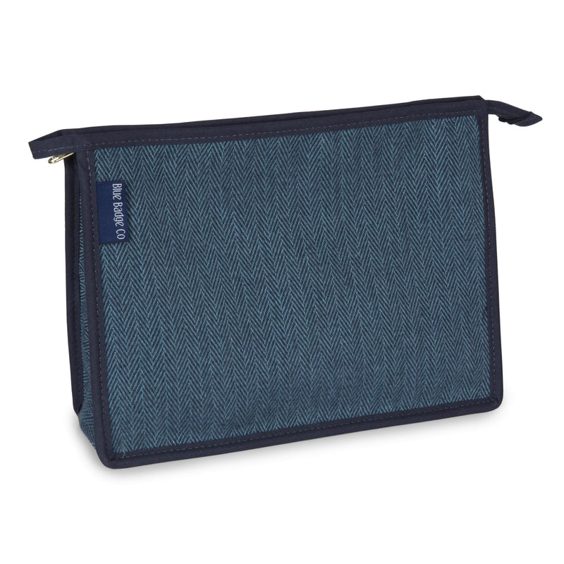 Toiletry Bag, Wash Bag in Herringbone with blue badge company label showing against a white background