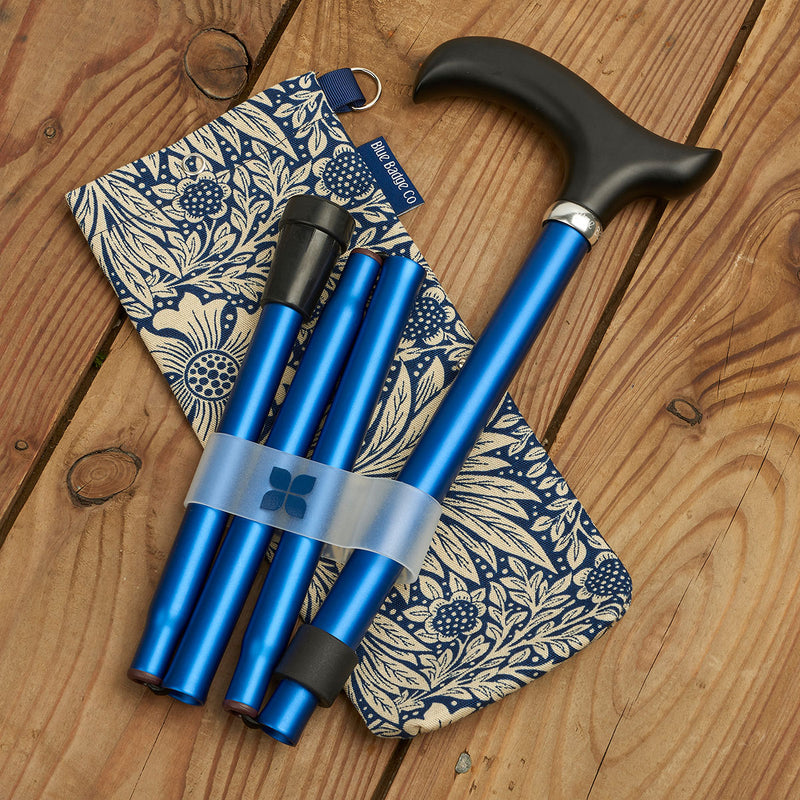 Adjustable Folding Walking Stick in Navy & Fabric Storage Bag in William Morris Marigold Indigo on wooden floor