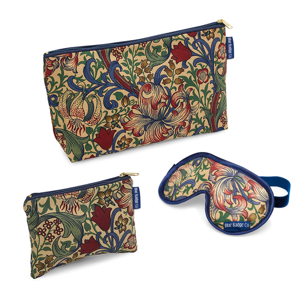 Toiletry Bags & Eye Mask Bathroom Gift Set in William Morris Golden Lily with blue badge company labels showing against a white background