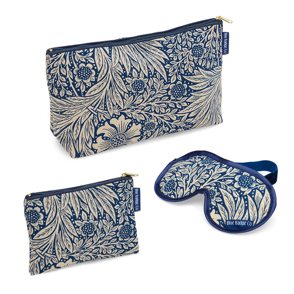 Toiletry Bags & Eye Mask Bathroom Gift Set in William Morris Marigold Indigo with blue badge company labels showing against a white background
