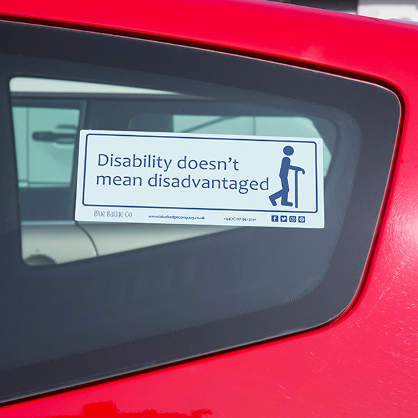 Disabled Car Sticker Rectangle  - Disability doesn't mean disadvantaged is stuck on the inside of a red car