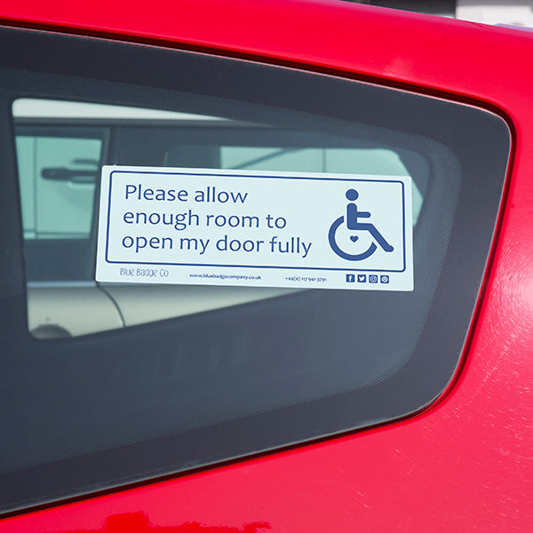 Disabled Car Sticker Rectangle  - Please allow enough room to open my door fully is in use on the inside of a car window