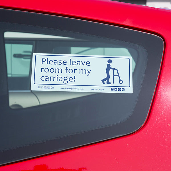 Disabled Car Sticker Rectangle - Please leave room for my carriage! is stuck on the inside of a car window