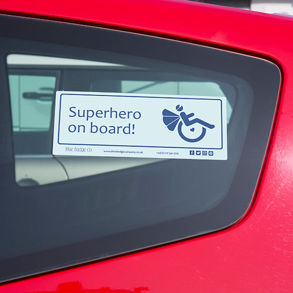 Disabled Car Sticker Rectangle - Superhero on board! is stuck on the inside of a car window