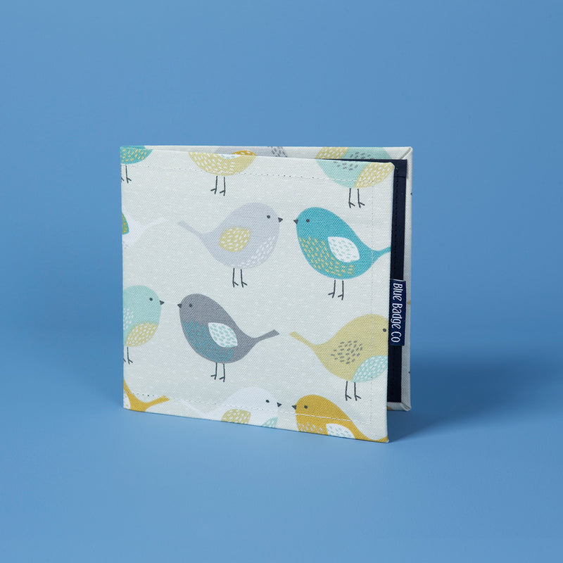 Disabled Blue Badge Wallet in Garden Birds behind a baby blue background