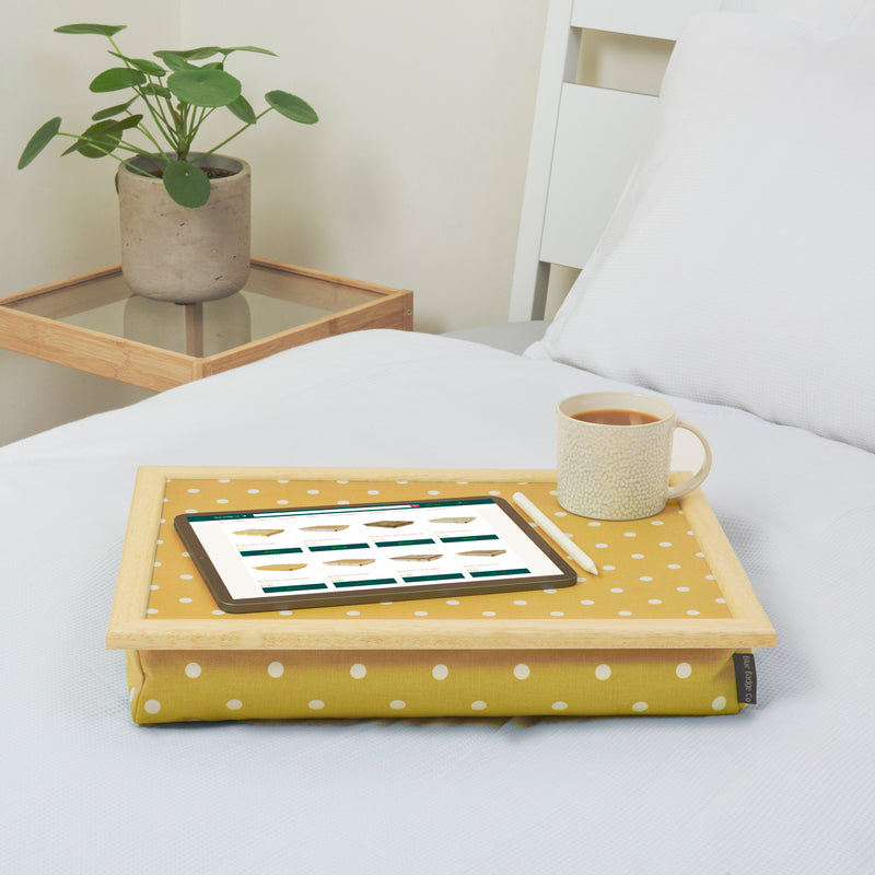 Canary Yellow Lap Tray with cushion on the bed with tablet and cup of tea on top