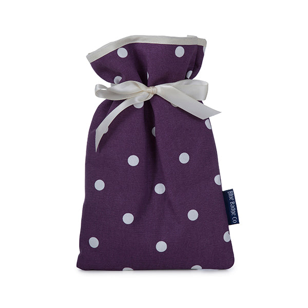 Mini Hot Water Bottle in Purple Spotty with white satin ribbon and blue badge company label