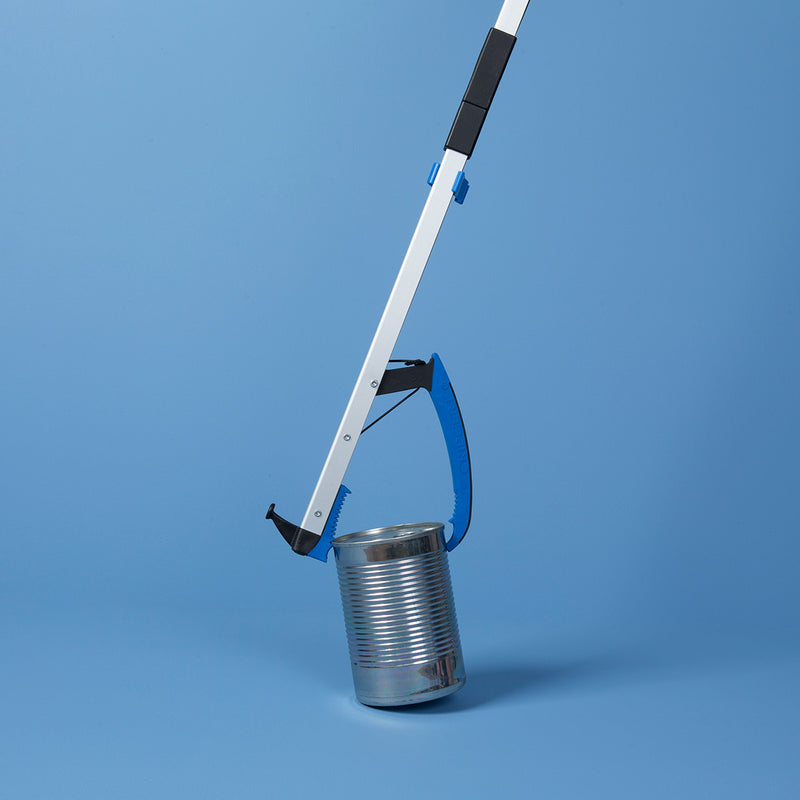 Folding Travel Reacher holding a tin can against a blue background
