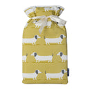 Large Hot Water Bottle in Sausage Dog with white satin ribbon and blue badge company label showing