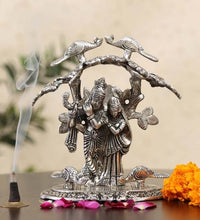 Load image into Gallery viewer, Silver White Metal Radha Krishna Idol Playing Flute Under Tree (Size, 22.7x17.8x14.2 cm) - CRAFT WORLD INDIA