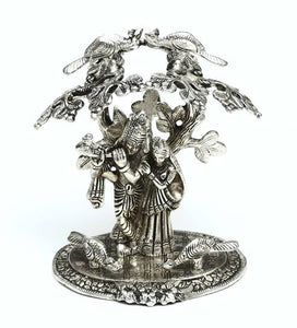 Silver White Metal Radha Krishna Idol Playing Flute Under Tree (Size, 22.7x17.8x14.2 cm) - CRAFT WORLD INDIA