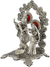 Load image into Gallery viewer, Silver White Metal Radha Krishna Idol Playing Flute with deepak (Silver, size 8 inch) - CRAFT WORLD INDIA