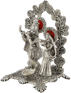 Silver White Metal Radha Krishna Idol Playing Flute with deepak (Silver, size 8 inch) - CRAFT WORLD INDIA