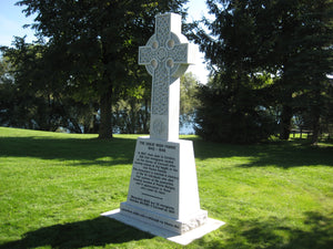 White upright monument with graphics by Grace Monuments