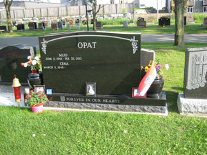 Black upright monument with graphics by Grace Monuments