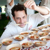 Jason Weiner of Almond Restaurant creating appetizers at a tasting event on VerTerra Dinnerware 3.5 Inch round bowls
