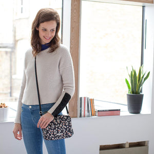Model wearing Mini Fix Leopard Baby Changing Bag | Shoulder Bag Changing Bag | Storksak - Award-winning Baby Changing Bags & Accessories