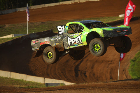 Kyle Chaney jumping Pro 4 Offroad Truck at ERX