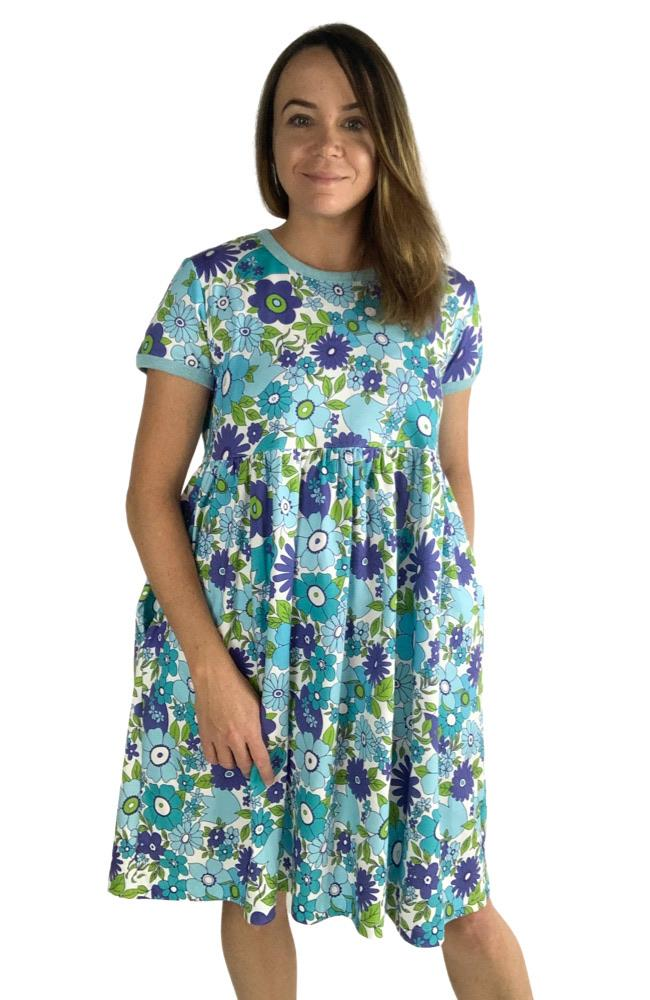 Women wearing a knee length short sleeve dress with a blue floral print