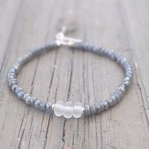 white frosted glass bead and grey seed bead bracelet